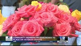 Local business hands out roses in remembrance of local veterans